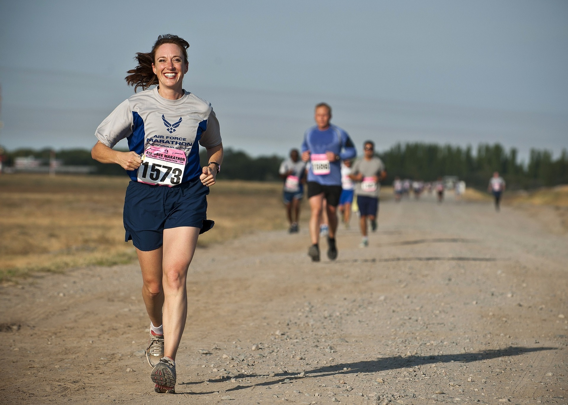 woman running a race